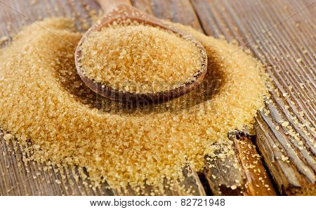 Brown Cane Sugar  In   Wooden Spoon