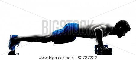 one caucasian man exercising fitness push ups weights exercises in studio silhouette isolated on white background