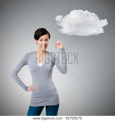 Dissatisfied woman gestures small amount, grey background