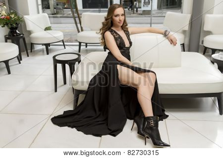 Glamourous Portrait Of The Young Beautiful Woman In Leather Boots And Stylish Dress. Trend Fashion L