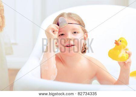 Cute little girl in the bathroom