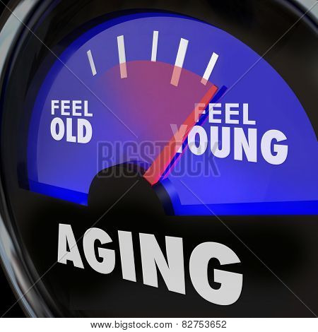 Aging word on a gauge to illustrate difference between feeling old and young, with energy and vigor of a youthful lifestyle, mind body and spirit