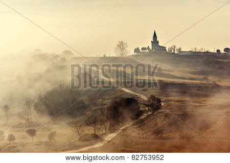 Misty Country Landscape With Church In La Garrotxa, Catalonia