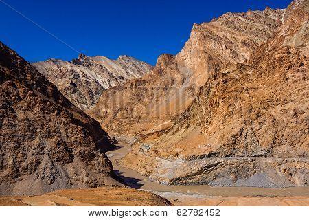 Crossing the Zanskar river during trek to Markha valley rafting mountain river Himalaya India Ladakh poster
