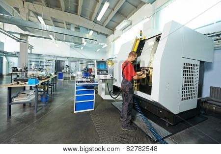 manufacture technician worker at factory metal machining shop