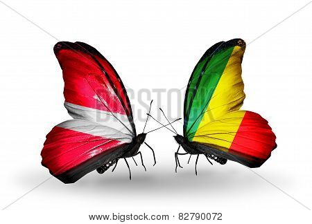 Two Butterflies With Flags On Wings As Symbol Of Relations Latvia And  Kongo