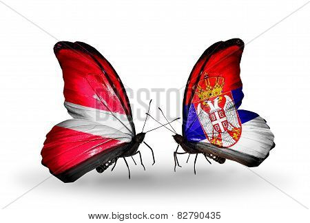 Two Butterflies With Flags On Wings As Symbol Of Relations Latvia And Serbia