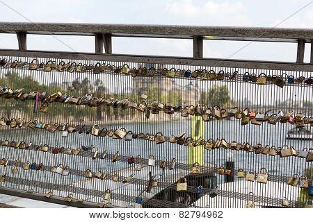 Love padlocks on the Passerelle Leopold Sedar-Senghor. poster