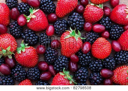 Berries, summer fruit on wooden table.