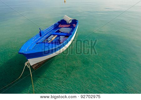 Azure Blue Motor Boat Floating On Calm Transparent Sea Water On Greek Kos Island