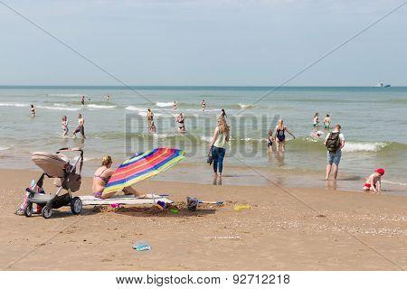Seaside Visitors  Relaxing At Dutch Beach Of Scheveningen