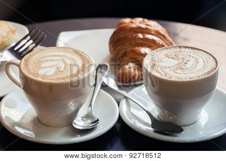 Cappuccino With Croissant. Two Cups Of Coffee