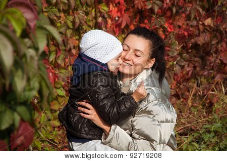 Happy mother and daughter embracing each other