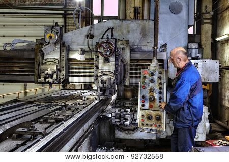 Working Machine Operator Controls The Processing Of Metal