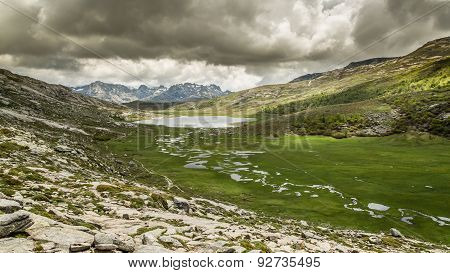 Lac De Nino In Corsica With Mountains In The Background