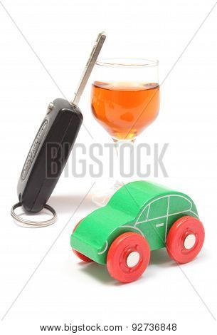 Toy Vehicle, Car Key And Glass Of Wine. White Background