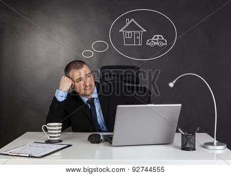 Businessman Dreaming In Office