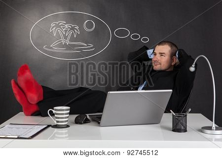 Businessman Relaxing And Dreaming