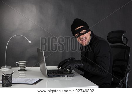 Hacker Stealing Data And Laughing
