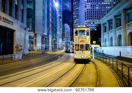 HONG KONG - JUNE 03, 2015: double-decker tram on street of HK. Hong Kong Tramways is a tram system in Hong Kong, being one of the earliest forms of public transport in the metropolis.