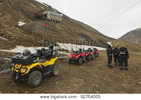 Tourists join the excursion on off-road vehicles near Longyearbyen, Norway.