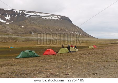 People set tents for a camp near Longyearbyen, Norway.