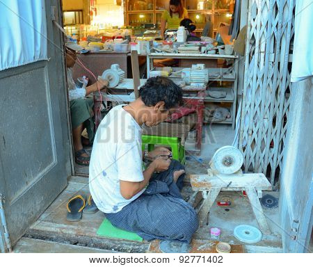 Lankan Man Grinds Moonstone