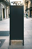 Black chalk board mockup on the street poster