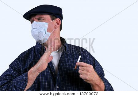 Man in mask repelled by cigarette