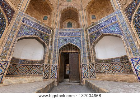 Gate of the Madrasah at the Poi Kalon square in Bukhara, Uzbekistan.