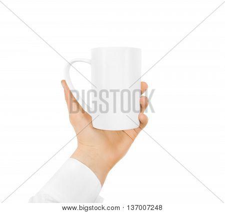 White blank mug mock up holding hand isolated on white. Empty ceramic tea cup hold handle. Clear drink mug mockup ready for logo design presentation. Teacup pot holder. Mug design texture template.