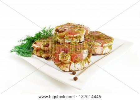 Raw Meat. Marinated pig rolls for barbecue. Delicacy isolated on a white.