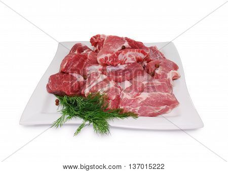 Raw Meat. Uncooked fresh pork slices isolated on white background