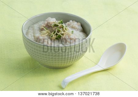 Traditional chinese porridge rice gruel in bowl with pork