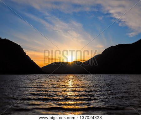 Glowing Orange Blue Sunset over Rippled Lake