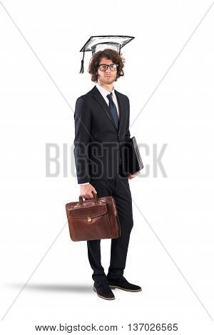 Man with graduation hat laptop and bag
