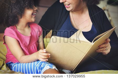 Mother Daughter Bonding Casual Reading Relax Concept