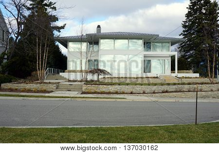 HARBOR SPRINGS, MICHIGAN / UNITED STATES - DECEMBER 25, 2015: A unique glass home on East Bluff Drive in Harbor Springs, with a view of Little Traverse Bay.
