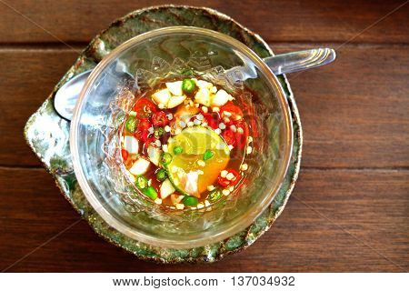 Chilli and fish sauce on the wood table