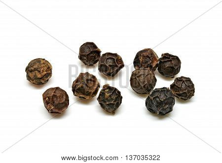 Black pepper corns on a white background