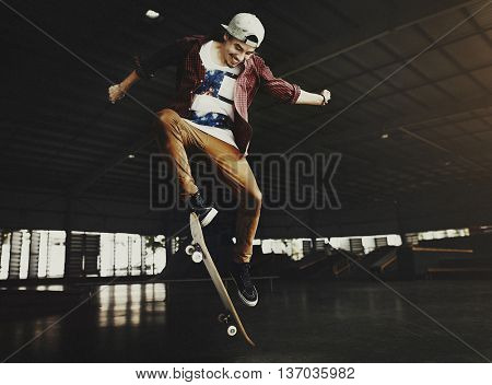 Boy Skateboarding Jump Lifestyle Hipster Exercise Concept