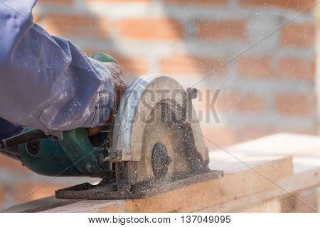 Carpenter Using Circular Saw In Loggers