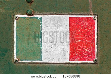 Italian flag on rusty old enamel sign