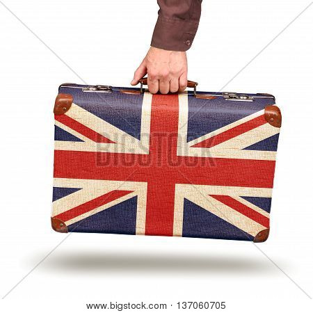 Hand holding vintage Union Jack flag suitcase isolated on white