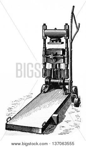 Press to reshuffle the bricks, vintage engraved illustration. Industrial encyclopedia E.-O. Lami - 1875.