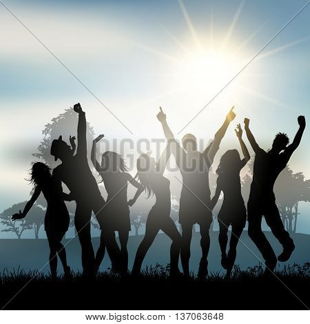 Silhouettes of people dancing in the countryside
