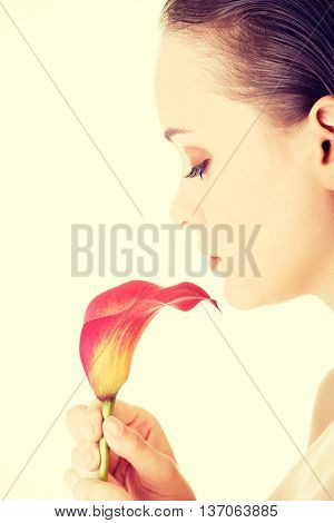 Young beautiful woman with flower.