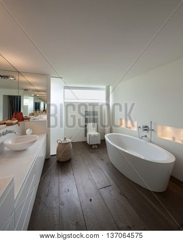 comfortable bathroom in modern design, wooden floor