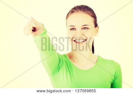 Woman making choose on abstract screen
