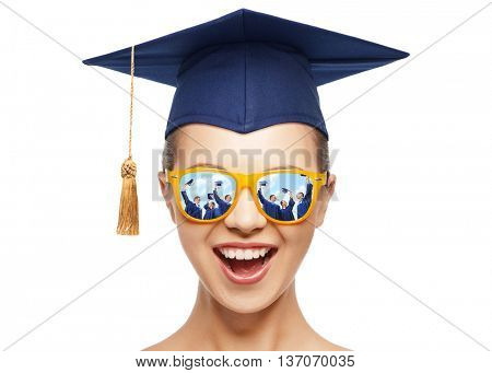 graduation, education, school and people concept - happy screaming teenage girl in shades and blue mortarboard or bachelor hat over white background